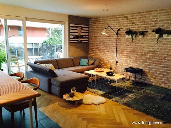 Wohnzimmer mit Natürliches Licht, Sichtmauerziegel